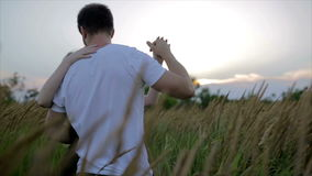 Romantic couple at sunset. Two people in love at sunset or sunrise. Man and woman have a good time together stock video