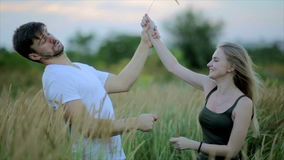 Romantic couple at sunset. Two people in love at sunset or sunrise. Man and woman have a good time together stock video footage