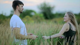 Romantic couple at sunset. Two people in love at sunset or sunrise. Man and woman have a good time together stock footage