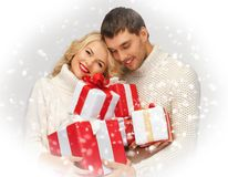 Romantic couple in a sweaters with gift boxes Royalty Free Stock Image