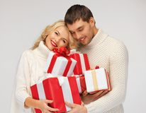 romantic couple in a sweaters with gift boxes Stock Images