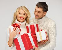 romantic couple in a sweaters with gift boxes Royalty Free Stock Photography