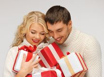 Romantic couple in a sweaters with gift boxes Stock Photo