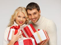 romantic couple in a sweaters with gift boxes Royalty Free Stock Photos