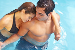 Romantic couple in swimming pool Royalty Free Stock Photos