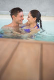 Romantic couple in swimming pool Stock Images