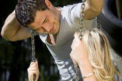 Romantic Couple Talking On A Swing Stock Photos