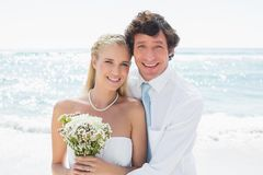 Romantic couple on their wedding day smiling at camera Royalty Free Stock Photography