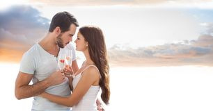 Romantic couple toasting champagne flutes against sky Royalty Free Stock Photography