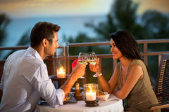 Romantic couple toasting during dinner stock photos