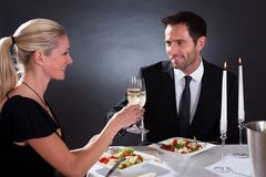 Romantic couple toasting each other Royalty Free Stock Image