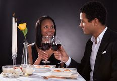 Romantic couple toasting red wine Royalty Free Stock Photography