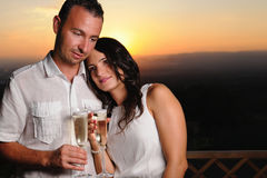 Romantic couple toasting at sunset Stock Photo