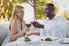 Romantic couple toasting their wine glasses Royalty Free Stock Photos