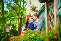 Romantic couple together on balcony Stock Images