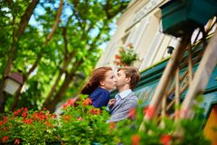 Romantic couple together on balcony Stock Photo