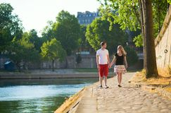 Romantic couple together near the Seine stock image