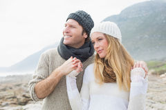 Romantic couple together on rocky landscape Stock Photos