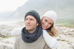 Romantic couple together on a rocky landscape Stock Image