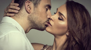 Romantic couple. Touching and kissing each other royalty free stock photography