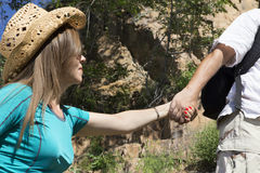 Romantic couple of tourists rises in the mountains Stock Photography