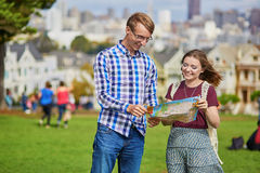 Romantic couple of tourists using map in San Francisco, California, USA Royalty Free Stock Photos