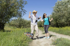 Romantic couple of tourists walking in love Royalty Free Stock Images