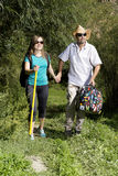 Romantic couple of tourists walking in love in the mountains Stock Images