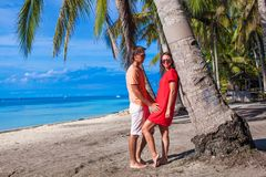 Romantic couple at tropical beach near palm tree Royalty Free Stock Images