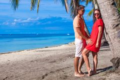Romantic couple at tropical beach near palm tree Royalty Free Stock Photo