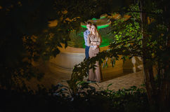 Romantic couple in the tropical jungle near the fountain Stock Photos