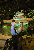 Romantic couple in the tropical jungle near the fountain Royalty Free Stock Photo