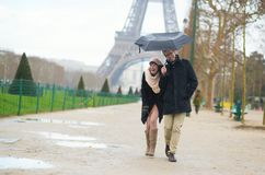 Romantic couple under the rain in Paris Stock Photo