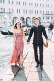 Romantic couple in Venice happy together and walking. Italy, Europe. royalty free stock photos