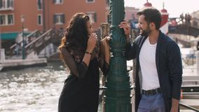 Romantic couple in Venice, Italy. Romantic tourist couple in love on pier in Venice, Italy. Beautiful view on bridge venetian gondolas boats on sea. Happy young stock footage