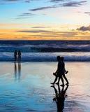 Romantic couple walk  beach Bali Stock Image