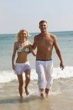 Romantic couple walking. Down on the beach Stock Photos