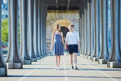 Couple walking along Bir-Hakeim bridge in Paris, France Royalty Free Stock Images