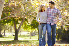 Romantic Couple Walking Through Autumn Woodland Stock Images