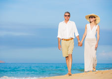 Romantic Couple Walking on the Beach Royalty Free Stock Photography