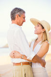 Romantic Couple Walking on the Beach Royalty Free Stock Images