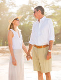 Romantic Couple Walking on the Beach Stock Photography