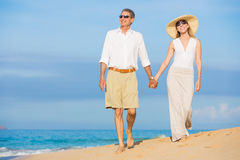 Romantic Couple Walking on the Beach Stock Images