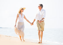 Romantic Couple Walking on the Beach Royalty Free Stock Photo