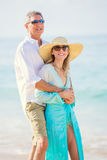 Romantic Couple Walking on the Beach Royalty Free Stock Photos