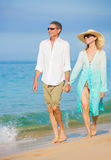 Romantic Couple Walking on the Beach Royalty Free Stock Image