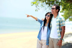 Romantic couple walking by the beach Royalty Free Stock Photo