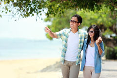 Romantic couple walking by the beach Royalty Free Stock Image