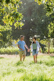 Romantic Couple Walking In Beautiful Countryside Royalty Free Stock Photo