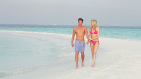Romantic Couple Walking On Beautiful Tropical Beach stock video